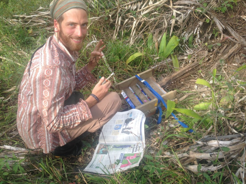 Nolan taking native plant samples to identify them on the land!