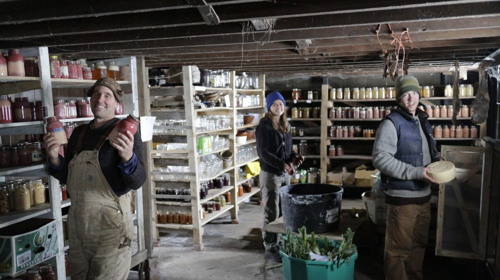 Ethan, Margaret and Dan show off some of the bounties of the Possibility Alliance: autumn olive jam, winesap apples, and cow's milk cheese.