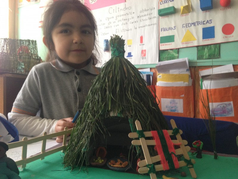 Sweet girl in the school explaining her model of a Ruca.