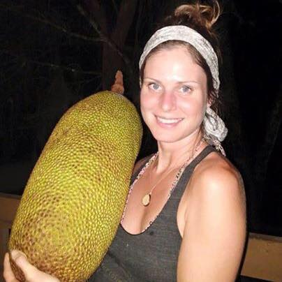 Brittney Johnson holding a large jackfruit straight off the tree in Costa Rica.