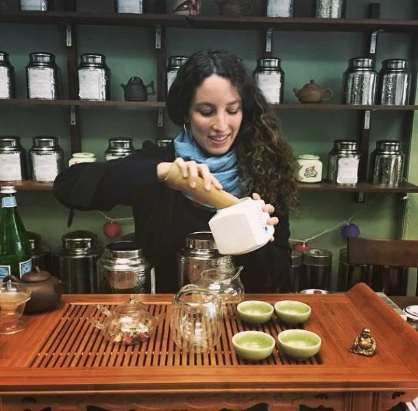 """Volunteer Koa Kalie in a photo inviting folks at The Western Gate teahouse to """"gather in the spontaneous experiment of connectivity and synchronicity, imbibing that which calls, enlivens and nurtures"""""""